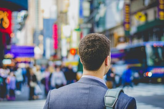 Man in Time's Square walking to his dream job.