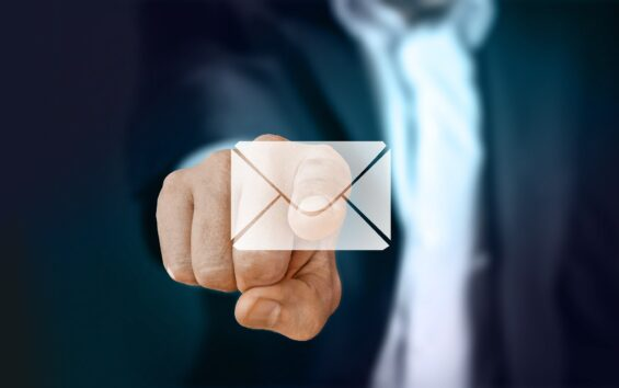 Businessman sending an email after copy and pasting email templates for quick and easy out of office messaging