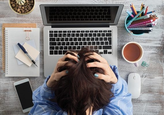 Excess information. Difficult situation, problems. Anxiety, stress, depression, loss of cortrol. Woman clasped head in hands. Throbbing splitting headache. Overwork, work too hard